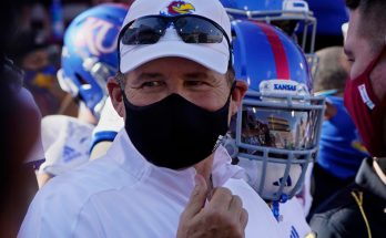Kansas' Les Miles on administrative leave amid LSU probe claims